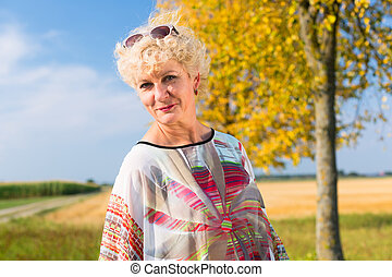 Senior woman enjoying the retirement outdoors in a sunny day in