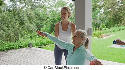 Senior woman exercising in a garden