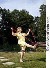 senior woman exercising in the garden