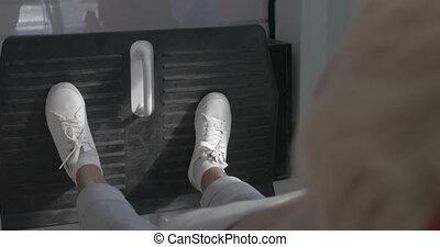 Senior woman exercising on fitness machine