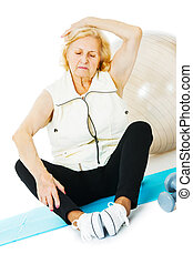 Senior Woman Exercising On Mat