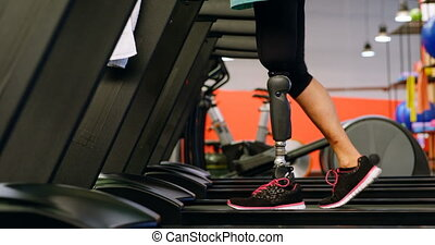 Senior woman exercising on treadmill in fitness studio 4k -...