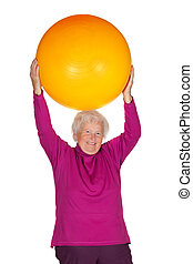 Senior woman exercising with gym ball - Cheerful overweight...