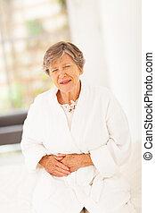 senior woman feeling sick at home