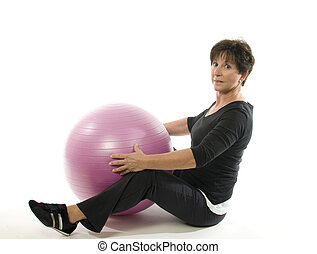 senior woman fitness exercise with core training ball