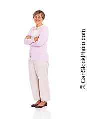 senior woman full length portrait standing on white...