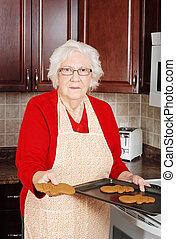 senior woman gingerbread snowman