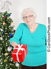 Senior woman giving christmas gift