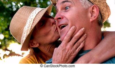Senior woman giving her partner