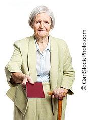 Senior woman giving passport over white background