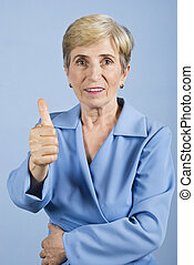 Senior woman giving thumbs up