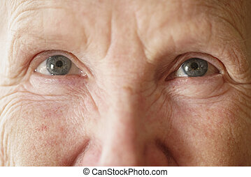 senior woman grandma eyes looking to camera close up portrait