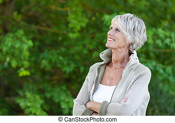 Senior woman - Happy senior woman looking at the beautiful...