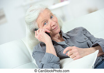 senior woman has a happy conversation on the phone