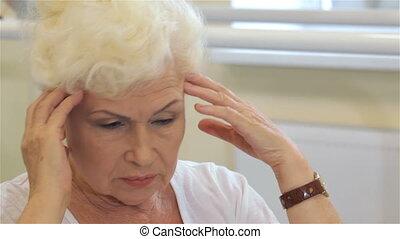 Senior woman has a headache