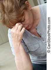 Senior woman having a headache