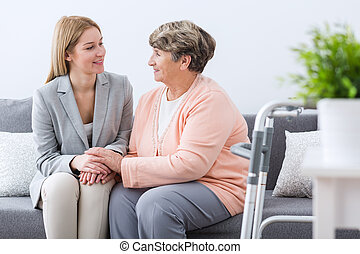 Senior woman having family support