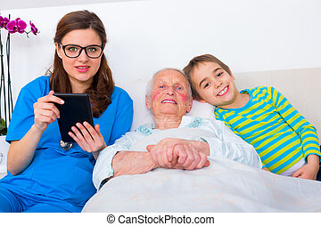 Senior woman having fun with family and doctor