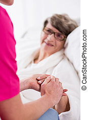 Senior woman having professional care