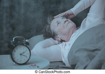 Senior woman having sleep disorder