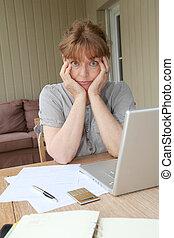Senior woman having trouble with tax declaration