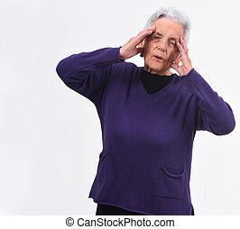 senior woman headache on white background