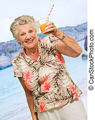 Senior Woman Holding A Glass Of Juice