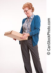 Senior woman holding a package
