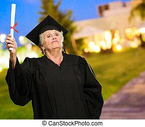 Senior Woman Holding Degree In Hand
