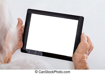 Senior Woman Holding Digital Tablet