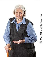 Senior woman holding medications over white