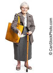 Senior woman holding money while standing on white