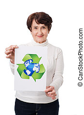 Senior woman holding recycling symbol