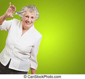 Senior woman holding scissors