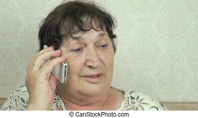 Senior woman holding smartphone talk to doctor