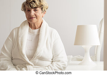 Senior woman in dressing gown