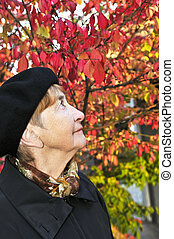 Senior woman in fall park
