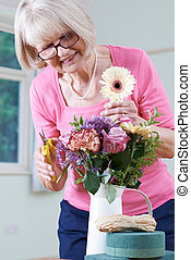 Senior Woman In Flower Arranging Class
