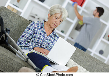 senior woman in front of a laptop