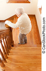 Senior Woman in front of Staircase