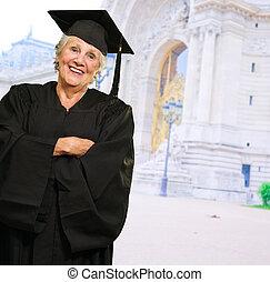 Senior Woman In Graduate Gown