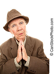 Senior woman in male clothes giving blessing