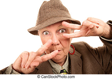 Senior woman in male clothing making hand fashionable gesture