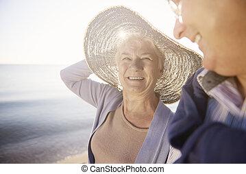 Senior woman in straw hat