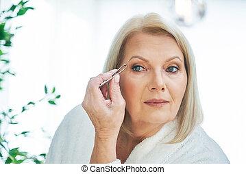 Senior woman in the bathroom