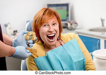 Senior woman in the dental office.