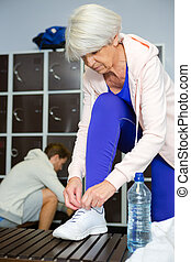 senior woman in the locker room