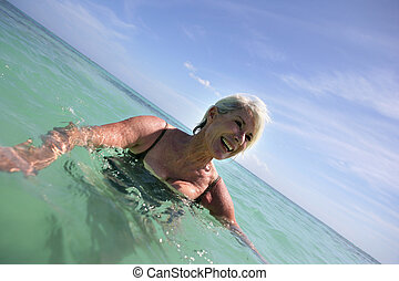 Senior woman in the sea
