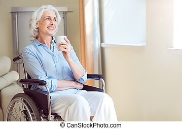 Senior woman in wheelchair at ward