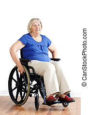 Senior woman in wheelchair over white